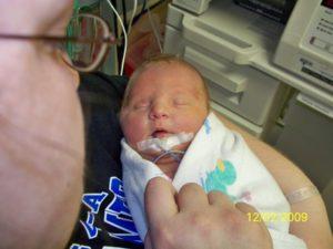 младенец с недугом
